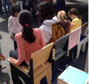 Kids visiting the Faire chill out in AtFAB chairs